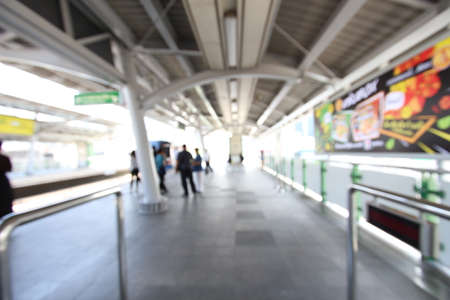 Blurred of the sky train is coming to the platform in the afternoon.
