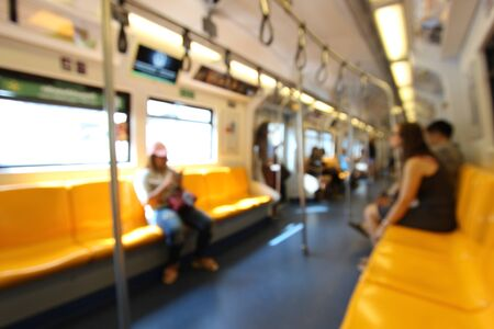 People are sitting and play smartphone in train in downtown Bangkok. Blurred picture. Stock fotó - 80076224