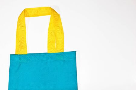 handlers: Green bag on a white background