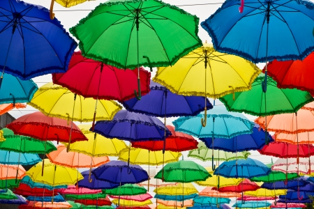 Multicolored umbrella hanging on the sky photo