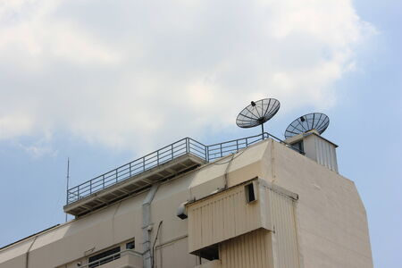 Satellite dish on the top of building  photo