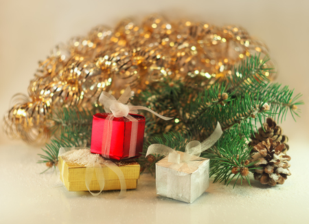 christmas and new year decorations with fir branch and gift boxes photo