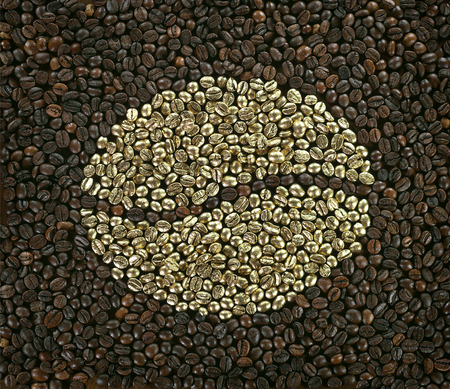 gold coffee bean made of golden beans on arabica coffee background photo