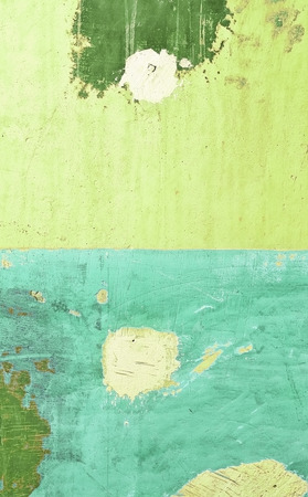 abstract grungy background with green painted wall and plaster spots with space for your text photo