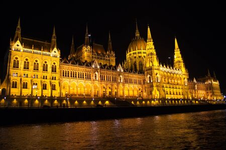 Hungary parliament in Budapest at night. Photo taken from Danube photo