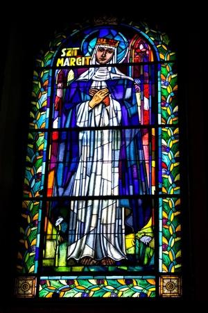 catholic angel: Stained glass window with bible motive. Saint Margit
