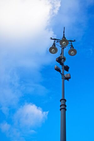 lamp post: Old decorative lamp against blue sky.