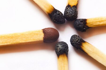 Macro photo of single match standing out against used matches Stock Photo - 12209619