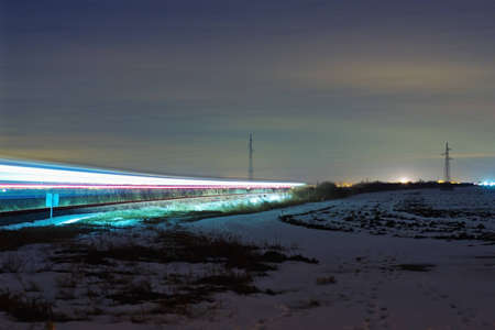 wood railroad: Night shot of passing train trails at winter Stock Photo