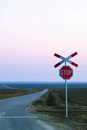 Lonely stop railway sign with cross in the evening Stock Photo - 12640513
