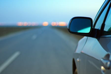Close up of car mirror at the evening
