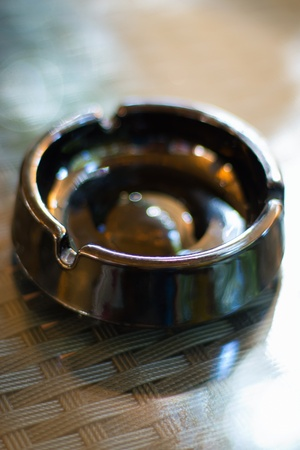 Empty black ashtray on the table on bar terrace  photo