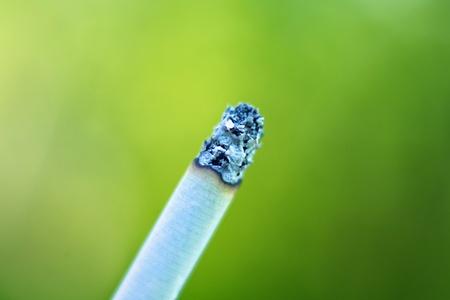 Macro of cigarette over blurred background Stock Photo