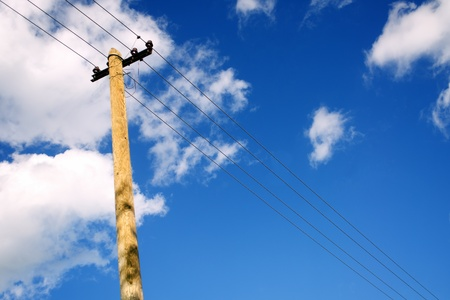 utility pole: Old telephone pole over cloudy blue sky Stock Photo