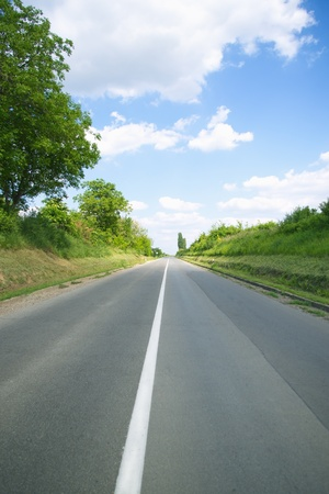 Empty rural road on sunny day photo