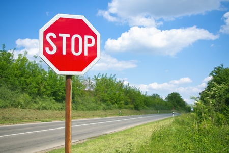 highway signs: Stop sign by the freeway