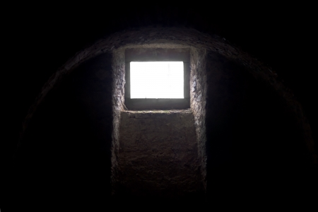 Medieval scary blank window in castle basement photo