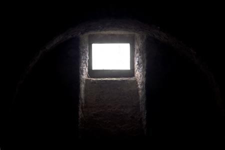 Medieval scary blank window in castle basement