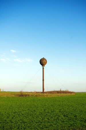 Old rusty water tower in the field photo