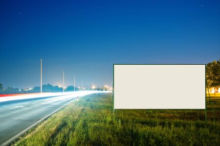 Blank advertising billboard by the busy road at night Stock Photo - 21066231