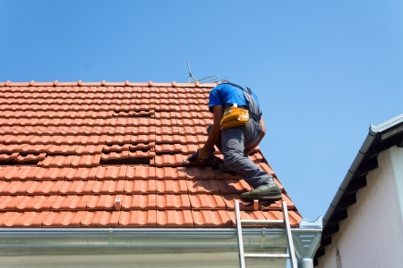 Worker repairing roof photo