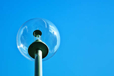Close up of modern street lamp post photo