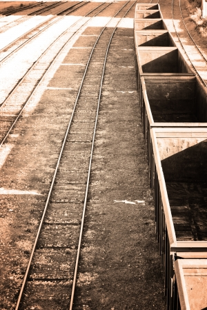 Empty cargo train in retro sepia color scheme photo