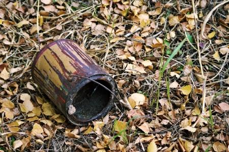 Old empty paint bucket on the ground  photo