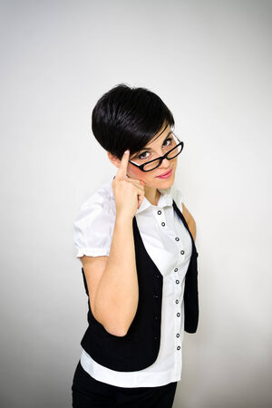 Retro young beautiful business woman wearing glasses  Stock Photo - 23577345