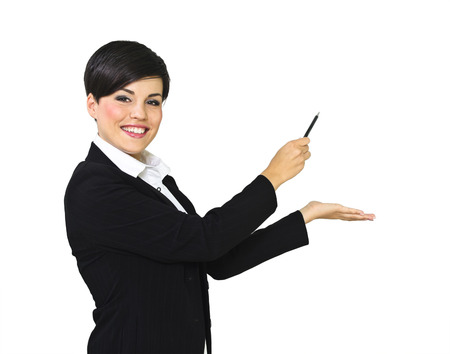 Young teacher presenting with pencil isolated over white background photo
