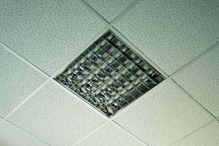 Modern office ceiling with close up on fluorescent light photo