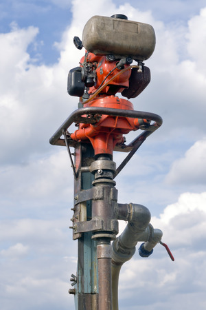 wells: Old small fuel powered machine for drilling wells or water bores