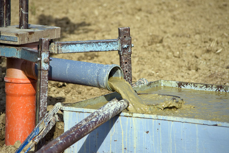 drilling well: Drilling water bore on agricultural field for irrigation  Stock Photo