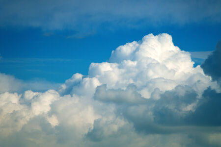 Soft fluffy cumulus clouds over blue sky photo