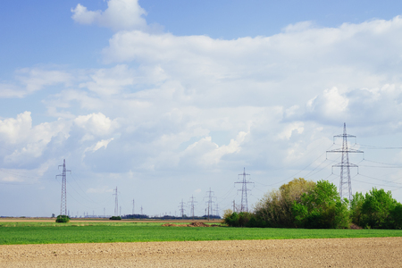 outdoor electricity: Distant transmission power lines in the field