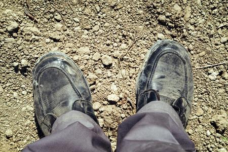 footsie: Footsie or feet selfie photo  Construction worker in the field