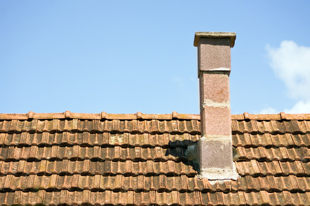 Retro chimney on the roof photo
