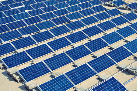 solar panel roof: Solar panel energy plant on flat roof under construction Stock Photo