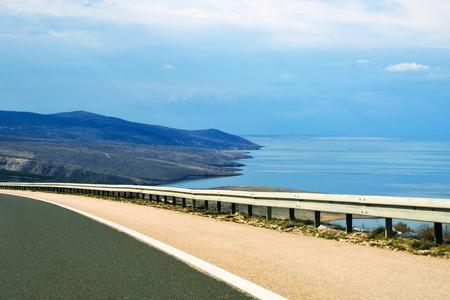 guard rail: Freeway guardrail by the sea