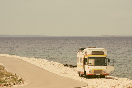 Retro van by the sea on the old vintage photo filter photo