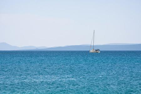 distant: Distant sailboat on the horizon