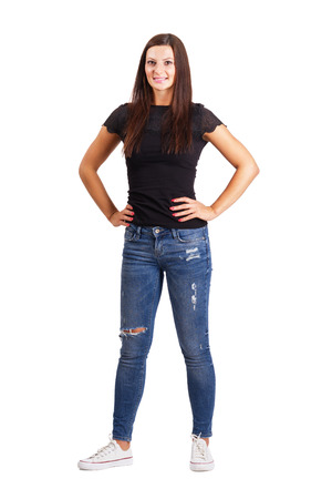 arms akimbo: Beautiful young brunette woman with arms on her hips. Full body length isolated over white.
