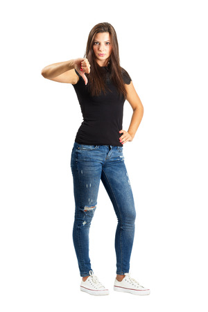 Attractive beautiful woman showing thumb down gesture. Full body length isolated over white.