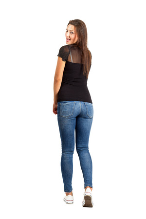 Back view posing casual brunette beauty. Full body length isolated over white. photo
