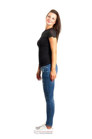 Smiling beautiful brunette posing. Full body length isolated over white. photo