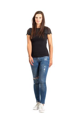 Walking long hair brunette woman front view. Full body length isolated over white. Stockfoto