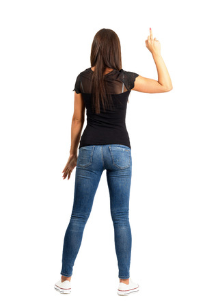 Backside view of trendy casual woman with middle finger gesture. Full body length isolated over white background.