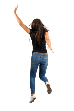 Young long hair woman jumping or running away. Backside view. Full body length isolated over white background. photo