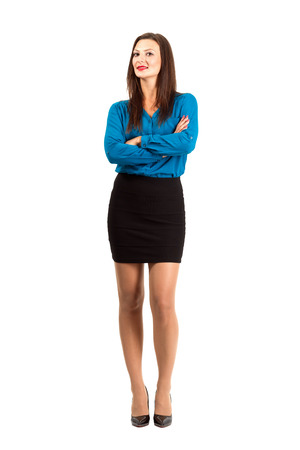 nylon: Confident modern business woman with crossed or folded hands. Full body length isolated over white background.