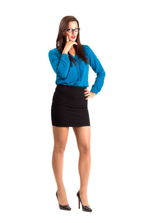 business woman legs: Sexy teacher with glasses thinking looking at camera. Full body length isolated over white background.
